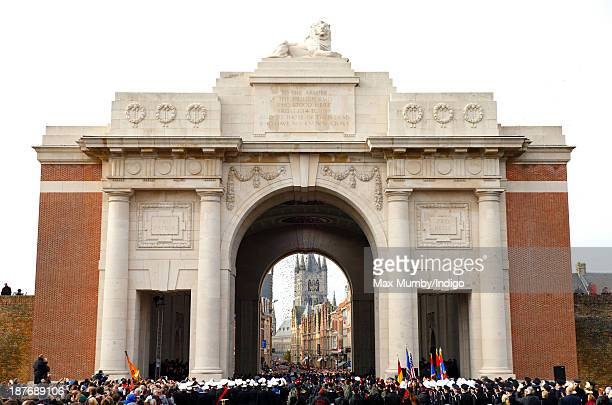 Poppies drop from the roof of the Menin Gate during a ceremony to mark Armistice Day on November 11 2013 in Ypres Belgium