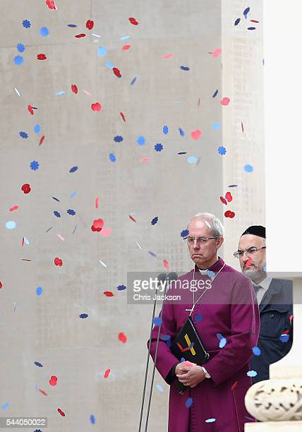 Poppies fall past Archbishop Justin Welby walks past names on the Thiepval Memorial during Somme Centenary Commemorations on July 1, 2016 in...