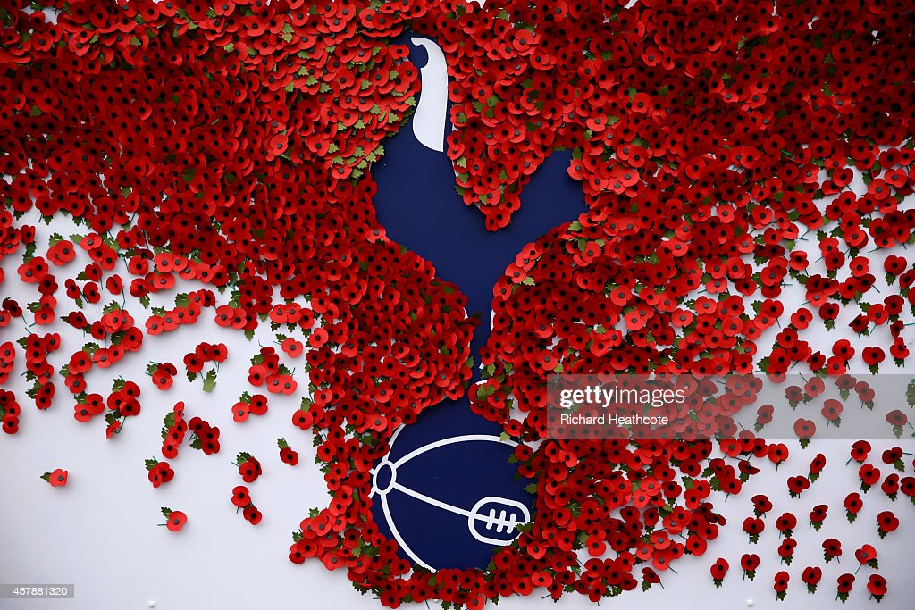 Poppies pinned to a Tottenham Hotspur board outside the stadium before the Barclays Premier League match between Tottenham Hotspur and Newcastle United at White Hart Lane on October 26, 2014 in London, England.