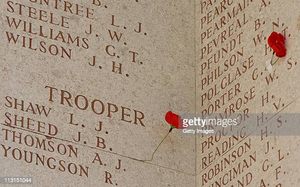 Poppies rest next to the names of the deceased during an Australian Memorial Service at the Lone Pine Memorial on April 25 2011 in Gallipoli Turkey...