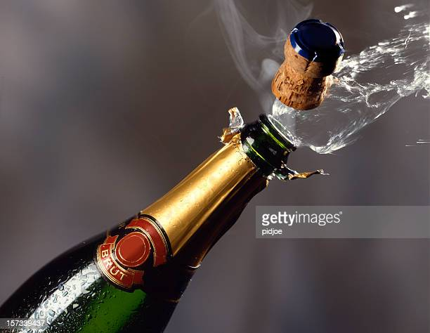 popping champagne cork - champagne cork stock photos and pictures