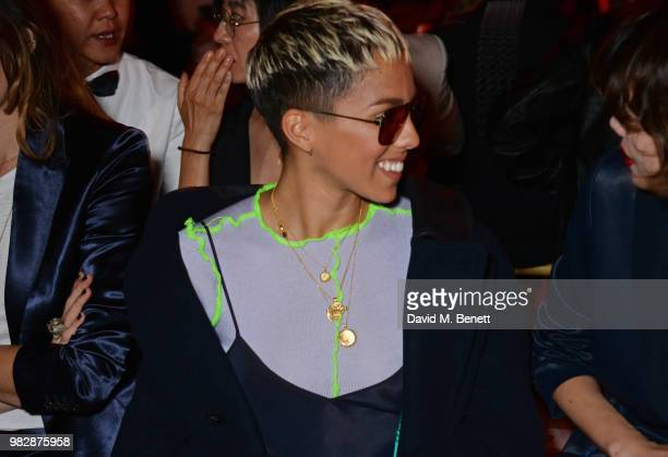 Poppy Ajudha wearing Paul Smith attends the Paul Smith SS19 Menswear Show during Paris Fashion Week at Elysee Montmartre on June 24 2018 in Paris...