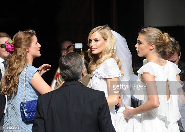 Poppy and Cara Delevingne arrive at the wedding on May 16 2014 in London England