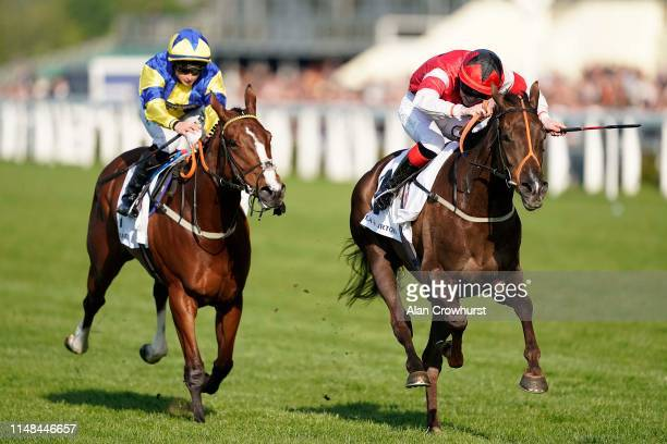 Poppy Bridgwater riding She Believes win The Stella Artois Silk Series Lady Riders' Fillies' Handicap at Ascot Racecourse on May 11 2019 in Ascot...