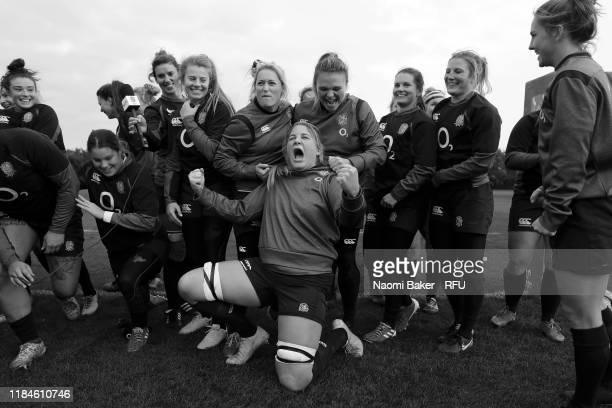 Poppy Cleall celebrates after the team record a message for the Men's England Team ahead of the Rugby World Cup Final during England Women's Training...