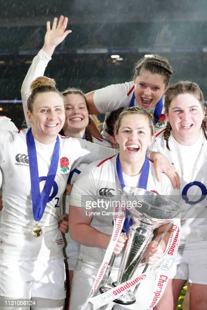 Poppy Cleall of England and Marlie Packer of England as the England team celebrate becoming Grand Slam Champions following the Women's Six Nations...
