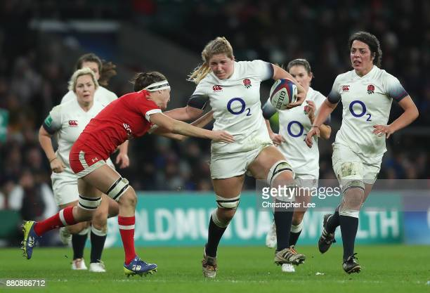 Poppy Cleall of England holds off Janna Slevinsky of Canada during the Old Mutual Wealth Series match between England Women and Canada Women at...