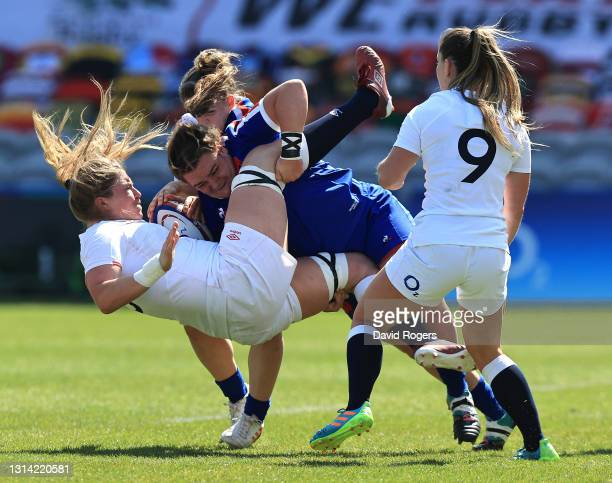 Poppy Cleall of England is tackled by Rose Bernadou during the Women's Six Nations match between England and France at Twickenham Stoop on April 24,...