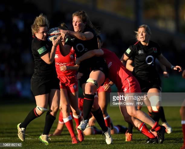 Poppy Cleall of England passes to teammate Marlie Packer during the Quilter International match between England Women and Canada Women at Castle Park...