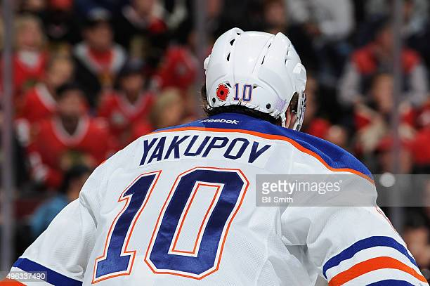 A poppy decal is shown on the helmet of Nail Yakupov of the Edmonton Oilers to commemorate Remembrance Day in Canada during the NHL game between the...