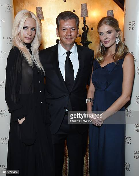 Poppy Delevigne George Koutsolioutsos and Donna Air attend the Links Of London 25th Anniversary Event at Loulou's on September 7 2015 in London...