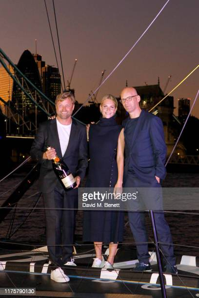 Poppy Delevingne, Alex Thomson and Mr Langer attend the The 'HUGO BOSS' Boat Christening Ceremony and Cocktail Party on September 19, 2019 in London,...
