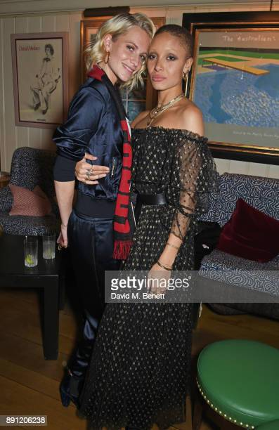 Poppy Delevingne and Adwoa Aboah attend the Love x Chaos x Poppy Delevingne x Moet Christmas Party at George on December 12 2017 in London England