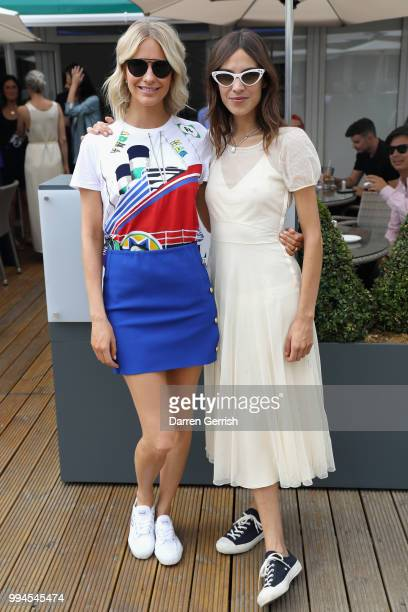 Poppy Delevingne and Alexa Chung attend the Polo Ralph Lauren and British Vogue Wimbledon day on July 9 2018 in London England