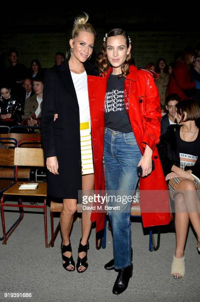 Poppy Delevingne and Alexa Chung wearing Burberry at the Burberry February 2018 show during London Fashion Week at Dimco Buildings on February 17...
