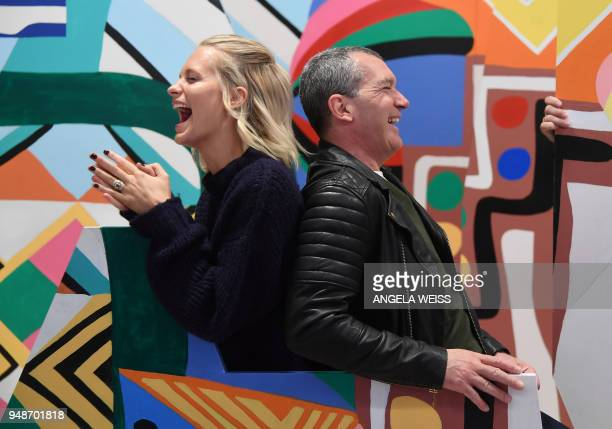 TOPSHOT Poppy Delevingne and Antonio Banderas pose at the National Geographic unveiling of 'Genius Studio' a oneofakind experimental art lab inspired...
