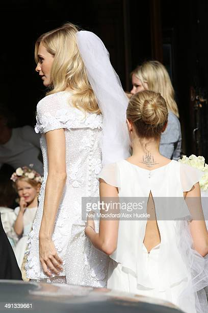Poppy Delevingne and Cara Delevingne arriving at the wedding of Poppy Delevingne and James Cook on May 16 2014 in London England