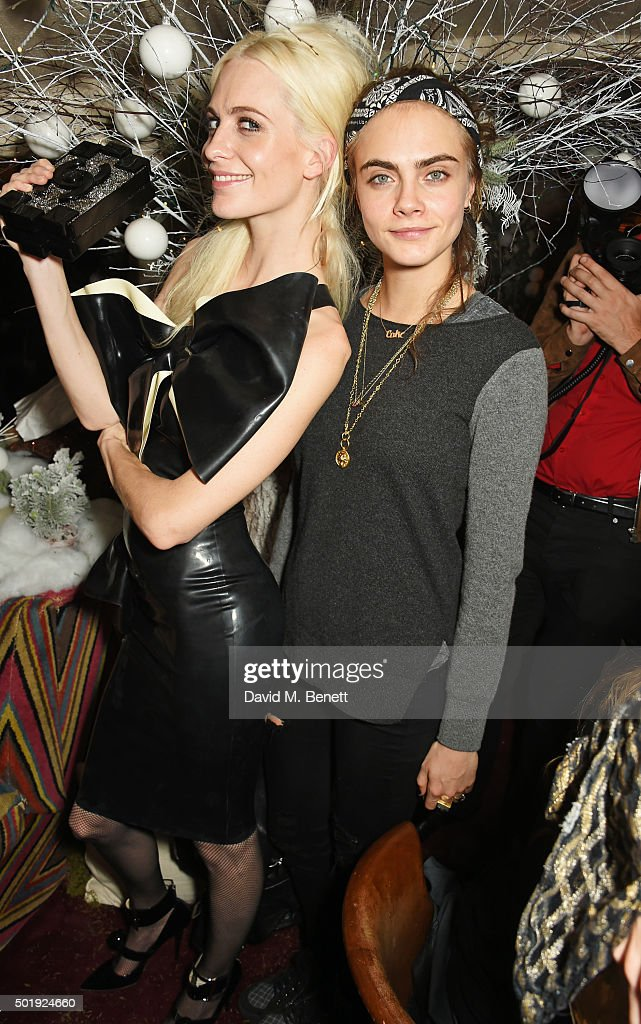 Poppy Delevingne (L) and Cara Delevingne attend the LOVE Christmas party at George on December 18, 2015 in London, England.