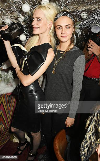 Poppy Delevingne and Cara Delevingne attend the LOVE Christmas party at George on December 18 2015 in London England