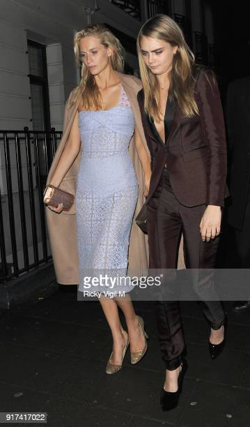 Poppy Delevingne and Cara Delevingne depart The Box Club after attending the Weinstein and Grey Goose preBAFTA Dinner on February 15 2014 in London...