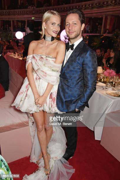 Poppy Delevingne and Derek Blasberg attend a drinks reception ahead of The Fashion Awards 2017 in partnership with Swarovski at Royal Albert Hall on...