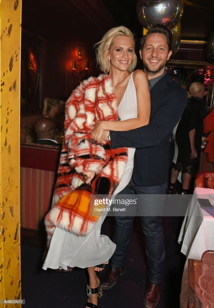 Poppy Delevingne (L) and Derek Blasberg attends the LOVE magazine x Miu Miu party, held during London Fashion Week, at Loulou's on September 18, 2017 in London, England.