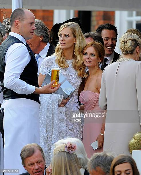 Poppy Delevingne and Geri Halliwell are seen at Poppy Delevingnes and James Cook's wedding reception held in Kensington Palace Gardens on May 16 2014...