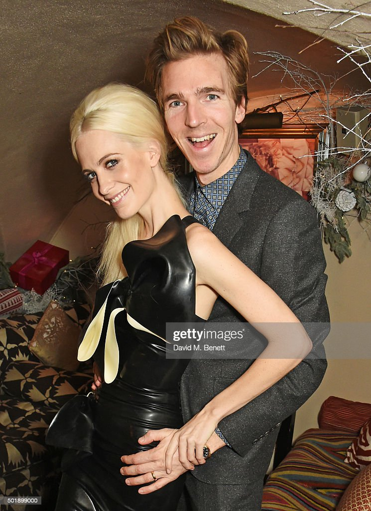 Poppy Delevingne (L) and husband James Cook attend the LOVE Christmas party at George on December 18, 2015 in London, England.