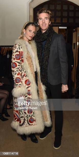 Poppy Delevingne and James Cook attend Carols By Candlelight in aid of the Lady Garden Foundation at Christ Church on December 3 2018 in London...
