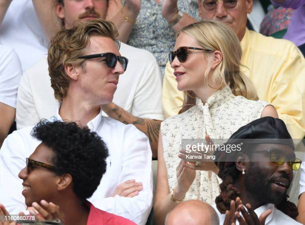 Poppy Delevingne and James Cook attend day seven of the Wimbledon Tennis Championships at All England Lawn Tennis and Croquet Club on July 08 2019 in...