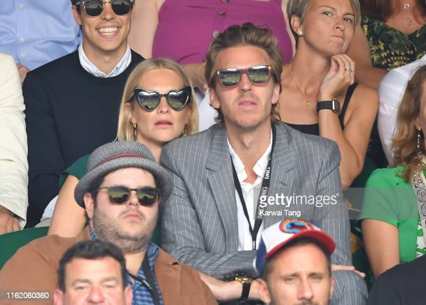 Poppy Delevingne and James Cook attend Men's Finals Day of the Wimbledon Tennis Championships at All England Lawn Tennis and Croquet Club on July 14...