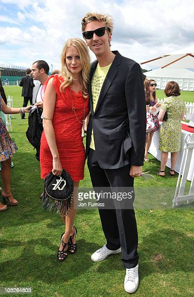 Poppy Delevingne and James Cook attend the Cartier International Polo Day at Guards Polo Club on July 25, 2010 in Egham, England.