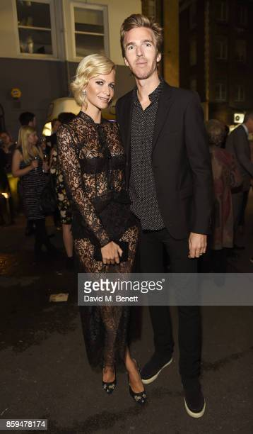 Poppy Delevingne and James Cook attend the Conde Nast Traveller 20th anniversary party at Vogue House on October 9 2017 in London England