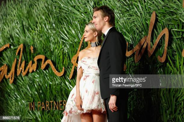 Poppy Delevingne and James Cook attend The Fashion Awards 2017 in partnership with Swarovski at Royal Albert Hall on December 4 2017 in London England