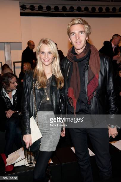 Poppy Delevingne and James Cook attend the Issa show during London Fashion Week Autumn/Winter 2009 at the BFC tent Natural History Museum on February...