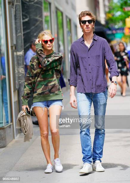 Poppy Delevingne and James Cook walk handinhand on May 5 2018 in New York City