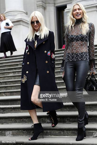 Poppy Delevingne and Jessica Hart attend the Christopher Kane show at Tate Britain during London Fashion week on September 19 2016 in London England
