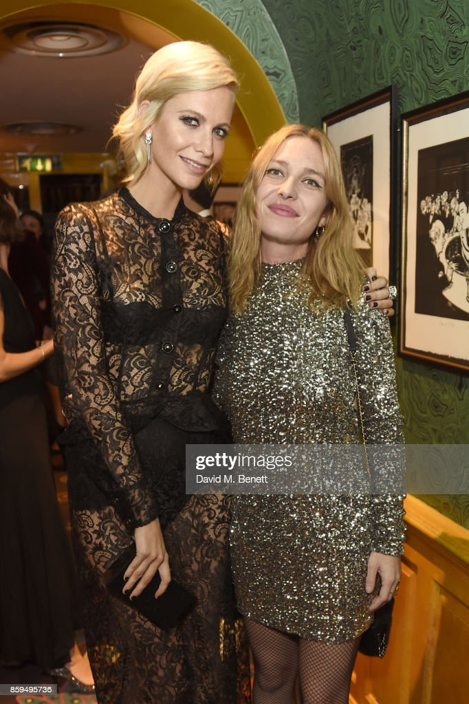 Poppy Delevingne (L) and Josephine de la Baume attend the Conde Nast Traveller 20th anniversary after party at Annabel's on October 9, 2017 in London, England.