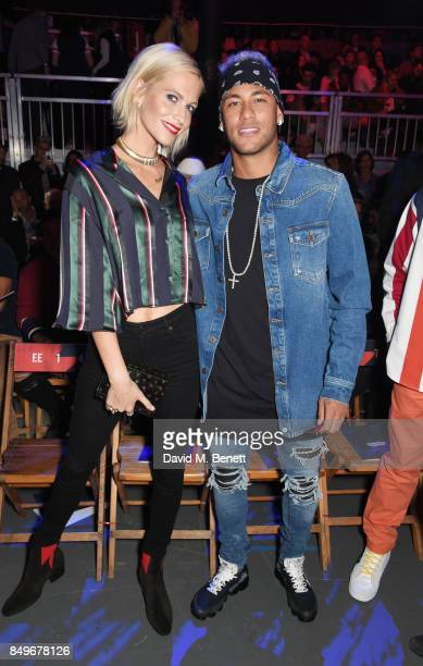 Poppy Delevingne and Neymar attend the Tommy Hilfiger TOMMYNOW Fall 2017 Show during London Fashion Week September 2017 at The Roundhouse on...