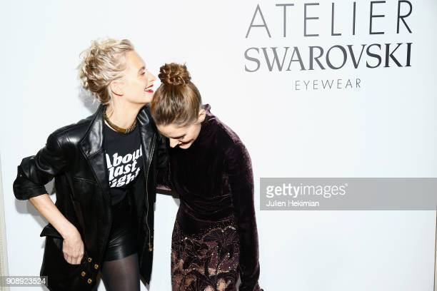 Poppy Delevingne and Olivia Palermo attend the Atelier Swarovski Eyewear Dinner as part of Paris Fashion Week at Hotel Crillon on January 22 2018 in...