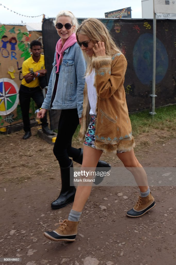 Poppy Delevingne (L) and Sienna Miller attend day 2 of the Glastonbury Festvial on June 24, 2017 in Glastonbury, England.