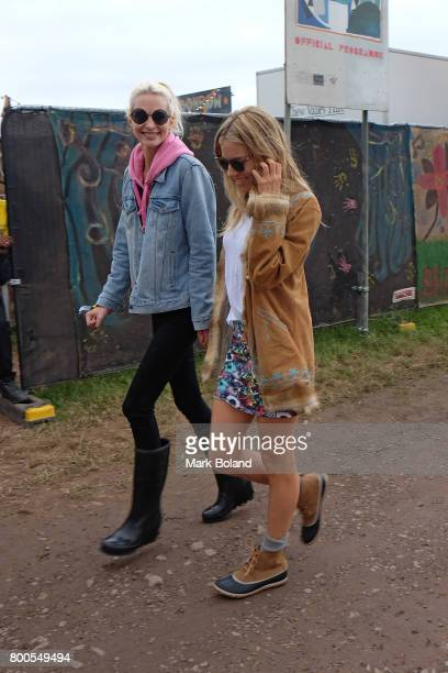 Poppy Delevingne and Sienna Miller attend day 2 of the Glastonbury Festival on June 24 2017 in Glastonbury England
