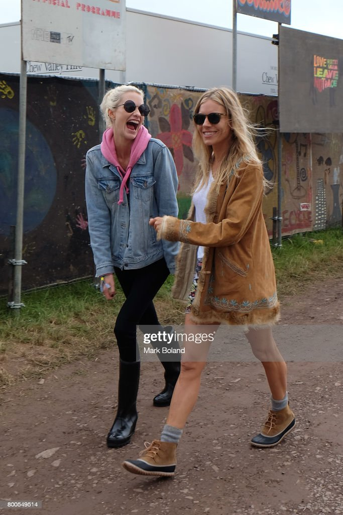 Poppy Delevingne (L) and Sienna Miller attend day 2 of the Glastonbury Festival on June 24, 2017 in Glastonbury, England.