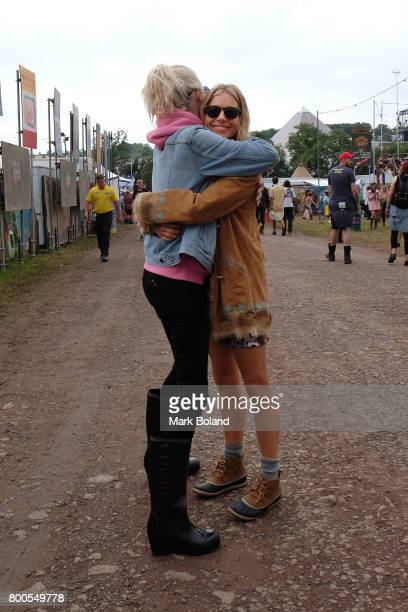 Poppy Delevingne and Sienna Miller attend day 2 of the Glastonbury Festival on June 24 2017 in Glastonbury England
