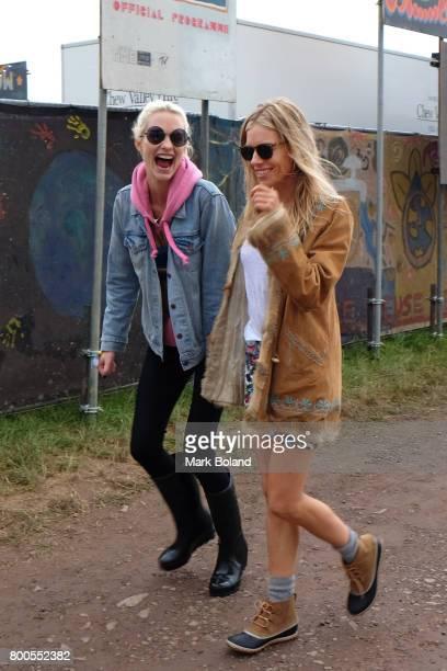 Poppy Delevingne and Sienna Miller attend day 2 of the Glastonbury Festvial on June 24 2017 in Glastonbury England
