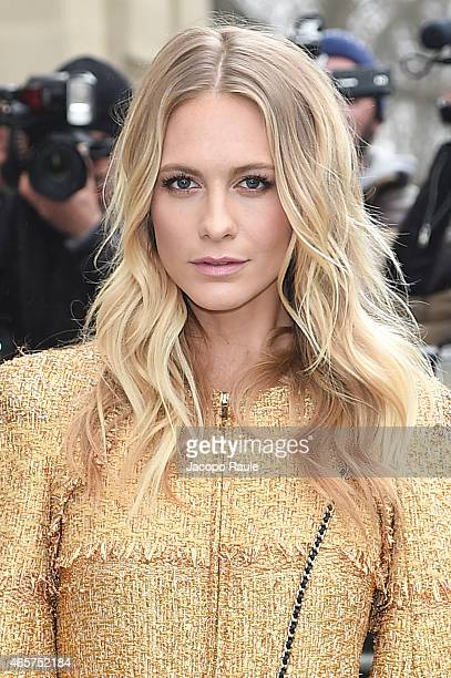 Poppy Delevingne arrives at Chanel Fashion Show during Paris Fashion Week Fall Winter 2015/2016 on March 10 2015 in Paris France