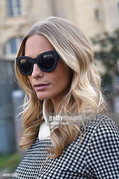 Poppy Delevingne arrives at Chloe Fashion Show during Paris Fashion Week Fall Winter 2015/2016 on March 8, 2015 in Paris, France.