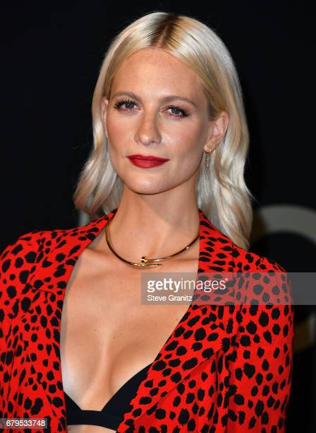 Poppy Delevingne arrives at the Panthere De Cartier Party In LA at Milk Studios on May 5 2017 in Los Angeles California