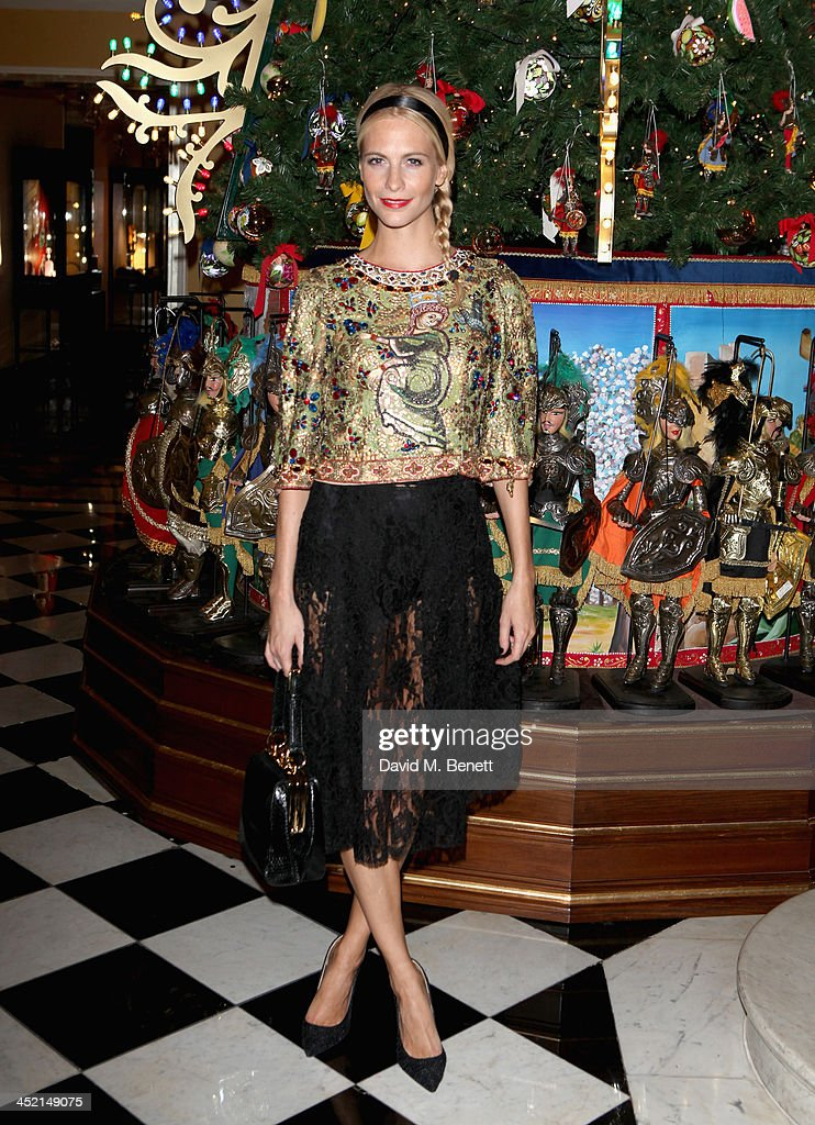 Poppy Delevingne attends Claridge's Christmas Tree By Dolce & Gabbana launch party at Claridge's Hotel on November 26, 2013 in London, England.