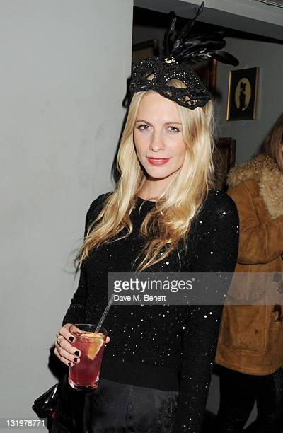 Poppy Delevingne attends the Alice Olivia Black Tie Carnival hosted by designer Stacey Bendet at Paradise by Way of Kensal Green on November 9 2011...
